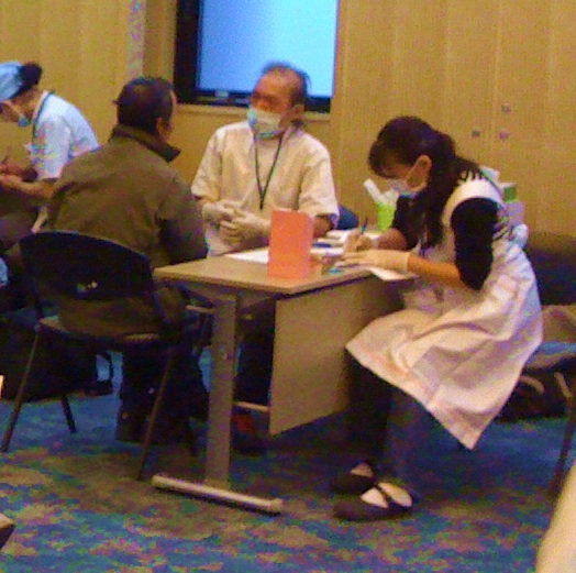 volunteers providing free health care to homeless individuals and families in kyoto